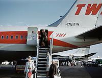 Travelers climbing down airplane, Germany
