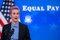 Megan Rapinoe, of the U.S. Soccer Women's National Team, delivers remarks during an event to mark Equal Pay Day in the State Dining Room of the White House in Washington, DC, USA, 24 March 2021. Equal Pay Day marks the extra time it takes an average woman in the United States to earn the same pay that their male counterparts made the previous calendar year.<br /> CAP/MPI/RS<br /> ©RS/MPI/Capital Pictures