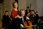 Alan Rickman British actor playing cello Juliet Stevenson British actress on film set of Truly Madly Deeply. 1991