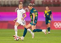 KASHIMA, JAPAN - JULY 27: Alanna Kennedy #14 of Australia passes the ball during a game between Australia and USWNT at Ibaraki Kashima Stadium on July 27, 2021 in Kashima, Japan.