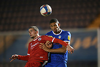 Omar Sowunmi of Colchester United and Max Watters of Crawley Town during Colchester United vs Crawley Town, Sky Bet EFL League 2 Football at the JobServe Community Stadium on 1st December 2020