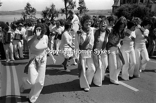 Padstow Hobby Horse, Padstow Cornwall, England 1975. May 1st.  Mayers accompany the junior version of the Old Oss.