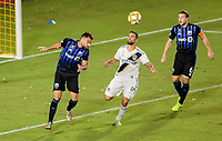 CARSON, CA - SEPTEMBER 21: Rudy Camacho #4 of the Montreal Impact  heads a ball during a game between Montreal Impact and Los Angeles Galaxy at Dignity Health Sports Park on September 21, 2019 in Carson, California.