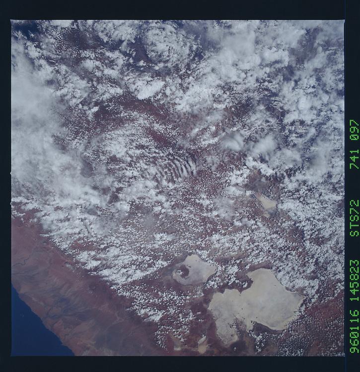 John Angerson. STS-72 Book.<br /> Public Domain Image.<br /> NASA images Courtesy National Archives - Record Group number: 255-STS-STS072<br /> Description: Earth observations taken from shuttle orbiter Endeavour during STS-72 mission.<br /> <br /> Subject Terms: STS-72, ENDEAVOUR (ORBITER), EARTH OBSERVATIONS (FROM SPACE)<br /> <br /> Date Taken: 1/16/1996<br /> <br /> Categories: Earth Observations<br /> <br /> Interior_Exterior: Exterior<br /> <br /> Ground_Orbit: On-orbit<br /> <br /> Original: Film - 70MM CT<br /> <br /> Preservation File Format: TIFF<br /> <br /> geon: PERU<br /> <br /> feat: SALAR DE UYUNI, CLOUDS<br /> <br /> lat: -18.5<br /> <br /> lon: -68<br /> <br /> tilt: 12<br /> <br /> cldp: 50<br /> <br /> nlat: -17.9<br /> <br /> nlon: -67.9<br /> <br /> dir: S<br /> <br /> azi: 102<br /> <br /> alt: 166<br /> <br /> elev: 66