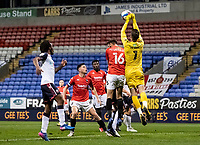 Salford City's goalkeeper Vaclav Hladky clears a Bolton Wanderers' attack<br /> <br /> Photographer Andrew Kearns/CameraSport<br /> <br /> The EFL Sky Bet League Two - Bolton Wanderers v Salford City - Friday 13th November 2020 - University of Bolton Stadium - Bolton<br /> <br /> World Copyright © 2020 CameraSport. All rights reserved. 43 Linden Ave. Countesthorpe. Leicester. England. LE8 5PG - Tel: +44 (0) 116 277 4147 - admin@camerasport.com - www.camerasport.com