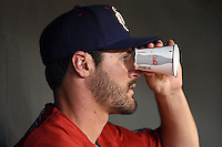 Oklahoma City RedHawks pitcher Nick Tropeano (16) fashions some Diet Coke cup binoculars during a game against the Memphis Redbirds on May 23, 2014 at AutoZone Park in Memphis, Tennessee.  Oklahoma City defeated Memphis 12-10.  (Mike Janes/Four Seam Images)