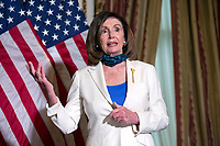 Nancy Pelosi Holds Enrollment Ceremony