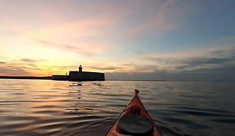 Club member Rob Collins, kayaking at dusk in Dun Laoghaire harbour