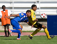 Jevani Brown (14) of Jamaica takes control of the ball in front of Jose Barralaga (13) of Honduras during the quarterfinals of the CONCACAF Men's Under 17 Championship at Catherine Hall Stadium in Montego Bay, Jamaica. Jamaica defeated Honduras, 2-1.