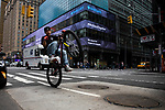A cyclist passes in front of Barclay's Investment Bank in New York on Wednesday, April 14, 2021. Photographer: Michael Nagle