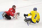 Benoit St-Amand, Sochi 2014 - Para Ice Hockey // Para-hockey sur glace.<br /> Team Canada takes on Sweden in Para Ice Hockey // Équipe Canada affronte la Suède en para-hockey sur glace. 08/03/2014.