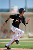 GCL Marlins center fielder Connor Scott (24) runs to first base during a game against the GCL Cardinals on August 4, 2018 at Roger Dean Chevrolet Stadium in Jupiter, Florida.  GCL Marlins defeated GCL Cardinals 6-3.  (Mike Janes/Four Seam Images)