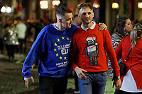 Pictured: Two young men wearing Christmas tops with one wearing a pro EU one in Wind Street, Swansea, Wales, UK. Friday 20 December 2019<br /> Re: Black Eye Friday (also known as Black Friday, Mad Friday, Frantic Friday) the last Friday before Christmas, in Swansea, Wales, UK.