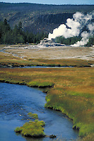 View of valley with mountains, water & geysers in Yellowstone National Park. Near Old Faithful. Yellowstone National Park Wyoming USA.