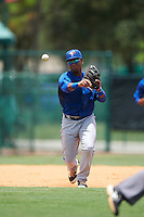 GCL Blue Jays third baseman Sterling Guzman (5) throws to first during a game against the GCL Braves on August 5, 2016 at ESPN Wide World of Sports in Orlando, Florida.  GCL Braves defeated the GCL Blue Jays 9-0.  (Mike Janes/Four Seam Images)