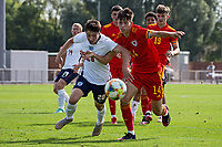 3rd September 2021; Newport, Wales:  Daniel Gore of England and Ben Hammond of Wales battle for the ball during the U18 International Friendly match between Wales and England at Newport Stadium in Newport, Wales.