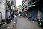 Indian people loiters on the main road of Sonagachi during 21 days lock down in India. Covid 19 pandemic has also affected the biggest red light area in Asia. Kolkata, West Bengal, India. Arindam Mukherjee.
