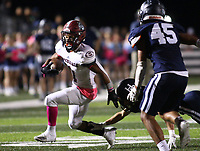 Davon Sparks (1) of Springdale running the ball tries to avoid David Barroso (94) of Springdale Har-ber on Friday, Oct. 8, 2021, during the first half of play at Wildcat Stadium in Springdale. Visit nwaonline.com/211009Daily/ for today's photo gallery.<br /> (Special to the NWA Democrat-Gazette/David Beach)