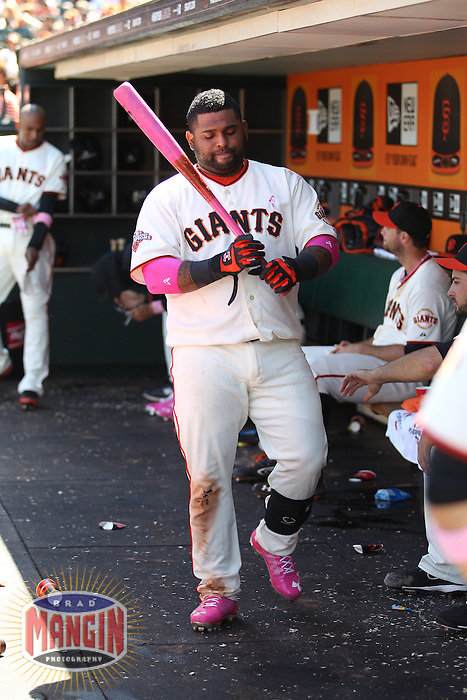 SAN FRANCISCO, CA - MAY 12:  Pablo Sandoval #48 of the San Francisco Giants walks in the dugout with a pink bat and pink shoes in honor of Mother's Day and breast cancer awareness against the Atlanta Braves during the game at AT&T Park on Sunday, May 12, 2013 in San Francisco, California. Photo by Brad Mangin