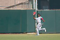 Surprise Saguaros center fielder Julio Pablo Martinez (40), of the Texas Rangers organization, prepares to catch a fly ball during an Arizona Fall League game against the Scottsdale Scorpions at Scottsdale Stadium on October 26, 2018 in Scottsdale, Arizona. Surprise defeated Scottsdale 3-1. (Zachary Lucy/Four Seam Images)