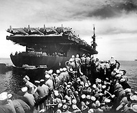 Liberty party.  Liberty section personnel aboard LCM returning to USS CASABLANCA from Rara Island, off Pitylieu Island, Manus. Admiralty Islands, April 19, 1945. PhoM1c. R. W. Mowday. (Navy)<br /> NARA FILE #:  080-CASA-618<br /> WAR & CONFLICT #:  899