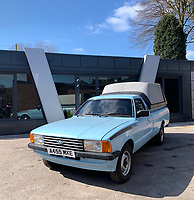 BNPS.co.uk (01202 558833)<br /> Pic: HampsonAuctions/BNPS<br /> <br /> Pictured: 1983 Ford P100 Pickup.<br /> <br /> Since the 1990s, Geoff Barlow, 46, has collected dozens of classic cars from an Escort Mexico replica to several types of Transit, Cortina, and Sierra.<br /> <br /> However, he still regrets selling the first car which inspired his passion, a 1980 Escort Mark 2 he bought from his sister in 1992.  <br /> <br /> Geoff's fascination with Fords gathered pace in the last decade and he 'lost control,' buying as many Fords as he came across and saving them from disrepair.