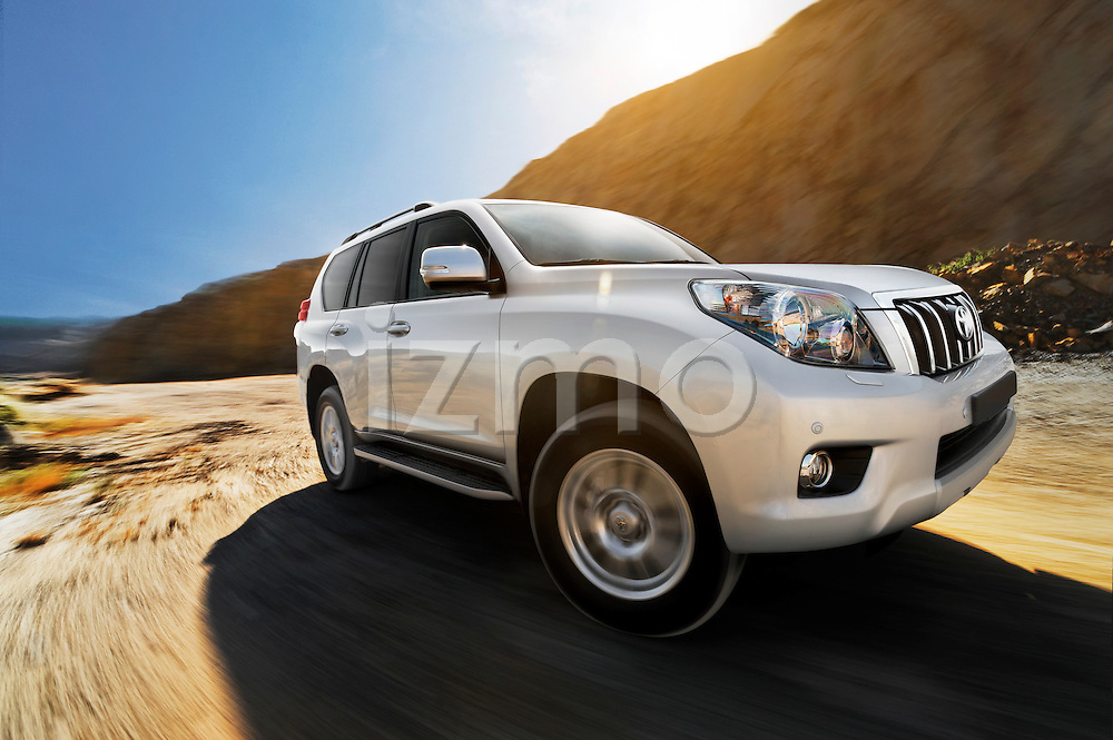 Automotive location photography of a 2011 Toyota Land Cruiser at a rock quarry.