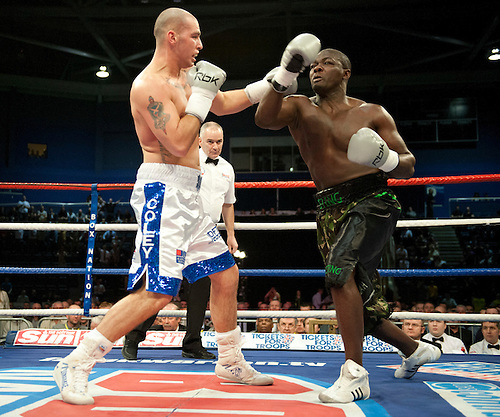 GLASGOW, SCOTLAND - MARCH 10: Stephen Simmons (white and blue shorts) exchanges blows with Hastings Rasani (black shorts) in a Cruiserweight contest on the Ricky Burns undercard at the Braehead Arena on March 10, 2012 in Glasgow, Scotland. (Photo by Rob Casey/Getty Images)