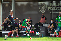 LAKE BUENA VISTA, FL - JULY 14: Nicolas Lodeiro #10 of the Seattle Sounders kicks the ball during a game between Seattle Sounders FC and Chicago Fire at Wide World of Sports on July 14, 2020 in Lake Buena Vista, Florida.