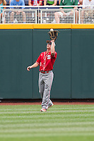 North Carolina State Wolfpack outfielder Brett Williams #3 catches a fly ball during Game 3 of the 2013 Men's College World Series between the North Carolina State Wolfpack and North Carolina Tar Heels at TD Ameritrade Park on June 16, 2013 in Omaha, Nebraska. The Wolfpack defeated the Tar Heels 8-1. (Brace Hemmelgarn/Four Seam Images)
