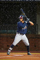 Mississippi Braves third baseman Rio Ruiz (5) at bat in the rain during a game against the Mobile BayBears on April 28, 2015 at Hank Aaron Stadium in Mobile, Alabama.  The game was suspended after the top of the second inning with Mobile leading 3-0, the BayBears went on to defeat the Braves 6-1 the following day.  (Mike Janes/Four Seam Images)