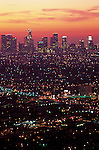 Row after row of city lights retreating into the distance from Griffith Park with downtown Los Angeles and skyscrapers, sunrise over LA, California USA