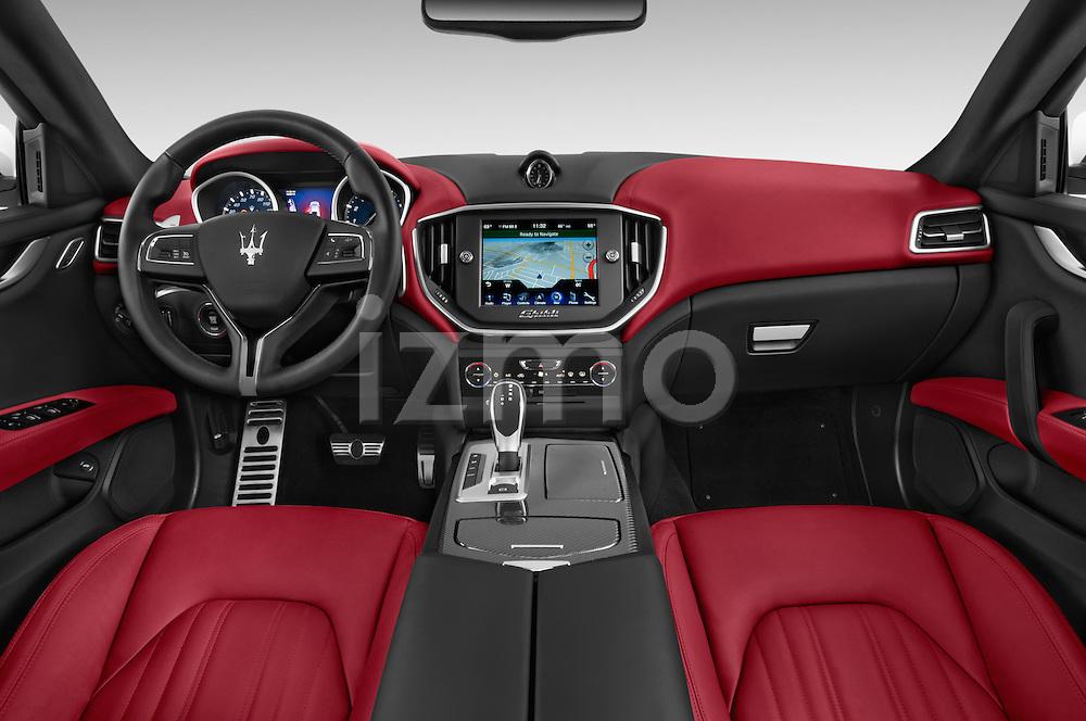 Stock photo of straight dashboard view of a 2014 Maserati Ghibli Base 4 Door Sedan Dashboard