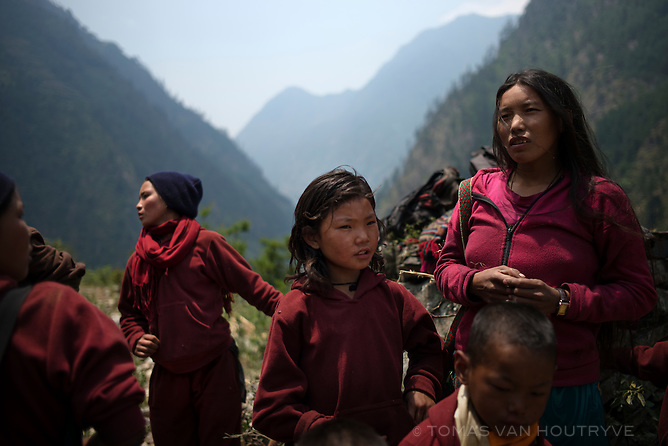 Residents are seen in the village of Bihi, Gorkha district, Nepal in June 2015.