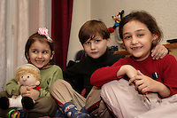 A Chechen Boy with is two sister, in a hotel room provide by the CAFDA in the centre of Paris. The father and the mother do not want be on the picture, they are afraid to be recognise and to be wanted, again..A afternoon, army men of Kadirov and the FSB force, break the entry door of there house, beat the grandfather and throw the father (the refugee) by the window. He wakeup in the hospital, with several injury. .In the meantime, 20 young men of is village get kidnap by the Kadirov army and Russian force and never come back..Getting out of the hospital, he hide himself in family or friends house, but he get arrest several time. His Mother, paid over 10 000.-Us dollar to corrupt government agents and to the Russian officer, over 4 years to liberate him 6 times. During this 4 years, the grandfather die of hopelessness and two of his brothers get murder. .He say: I am Muslim, I am a Moslem. The Russian army, the FSB, the Kadirov men, threat him permanently if he do not give names to them. And the Chechen independentis ask him to work with them. He refuse to both, he is Moslem..They left Chechnya in October 2004 to Brest in Byelorussia via Moscow. Arriving in Poland, the administration in Debak refugee centre, take there document and there finger print. They stay 3 week in Poland before to find a other smuggler who bring them by minivan to the border of Germany, were they wait the night, for cross a forest, a river and again a forest, to find a other minivan who bring them to Berlin and after to Hamburg.  The journey Warsaw to Hamburg, cost them 2500.-Euro..From Hamburg to Paris, they simply take a Eurolines bus (no more frontier, no more control), for 300.-Euro .They live since a year in a one room hotel, with no financial help by the French government, but have the Sécurité Social social security for medical assistance..The French government do not help refugees with food. 90% of the refugee depend on the Soupe populaire evening soup, give by the city adminis