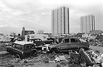 Irish Tinker scrap car metal dealers Gypsy inner city camp site Balsall Heath Birmingham UK 1968.<br /> <br /> Church of St Alban the Martyr in Conybere Street, Birmingham 12. Brinklow Tower block of flats in Highgate Street (centre ). and Wilmcote tower block to the right. Info thanks to David Papadopoulos and Kris Mallyboo, long time local resident. If anyone knows the name of the other large block can you let me know please. Many thanks.