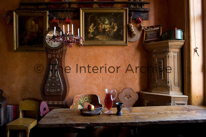 The kitchen is kept deliberately simple and furnished with antique wooden pieces
