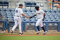 Charlotte Stone Crabs manager Jeff Smith (41) congratulates Izzy Wilson (9) after a home run during a Florida State League game against the Bradenton Maruaders on August 7, 2019 at Charlotte Sports Park in Port Charlotte, Florida.  Charlotte defeated Bradenton 3-2 in the second game of a doubleheader.  (Mike Janes/Four Seam Images)