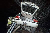 Firefighters attend a road traffic accident where the car was speeding, left the road and plunged down an embankment. It came to rest buried in a tree. The firefighters had to erect a system of ladders to reach and extricate the driver. They have set up portable lighting to enable them to work in the darkness...© SHOUT. THIS PICTURE MUST ONLY BE USED TO ILLUSTRATE THE EMERGENCY SERVICES IN A POSITIVE MANNER. CONTACT JOHN CALLAN. Exact date unknown.john@shoutpictures.com.www.shoutpictures.com...
