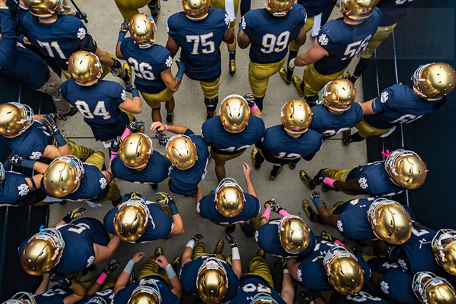October 29, 2016; The Football team walks out of the tunnel for the game against Miami. (Photo by Matt Cashore)