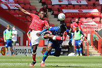 Chuks Aneke of Charlton and Wigan's Cedric Kipre challenge for the ball during Charlton Athletic vs Wigan Athletic, Sky Bet EFL Championship Football at The Valley on 18th July 2020