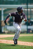 GCL Yankees East center fielder Jordan Scott (17) runs to first during a game against the GCL Pirates on August 15, 2016 at the Pirate City in Bradenton, Florida.  GCL Pirates defeated GCL Yankees East 5-2.  (Mike Janes/Four Seam Images)