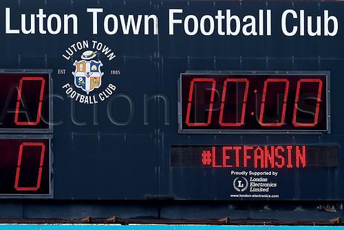 31st October 2020; Kenilworth Road, Luton, Bedfordshire, England; English Football League Championship Football, Luton Town versus Brentford; The Luton Town scores board displays #LetFansIn
