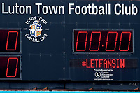 31st October 2020; Kenilworth Road, Luton, Bedfordshire, England; English Football League Championship Football, Luton Town versus Brentford; The Luton Town scores board displays #LetFansIn