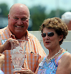 June 28, 2014:  Owners Corinne and L. William Heiligbrodt pose in the winner's circle after their two year old colt Cinco Charlie (Indian Charlie x Ten Halos, by Marquetry) wins the G3 Bashford Manor Stakes at Churchill Downs with jockey Shaun Bridgmohan.  Trainer Steve Asmussen.  Breeder Candyland Farm.  ©Mary M. Meek/ESW/CSM