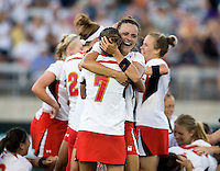 Karissa Taylor (20) celebrates with teammate Katie Schwarzmann (7) after the NCAA Championship held in Johnny Unitas Stadium at Towson University in Towson, MD.  Maryland defeated Northwestern, 13-11, to win the title.