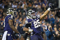 SAN FRANCISCO, CA - December 27, 2013: Washington Huskies tailback Bishop Sankey (25) celebrating his first touchdown of the game during the 2013 Kraft Fight Hunger Bowl where the Washington Huskies and the BYU Cougars at AT&T Park in San Francisco, California. Final score Washington Huskies 31, BYU Cougars 16.