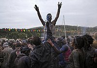 Pictured: Flour wars participants in Galaxidi, Greece. Monday 19 February 2018<br /> Re: Clean Monday (Monday of Lent) celebration of flour wars (Alevromoutzouroma) in the town of Galaxidi, which coincides with the beginning of the Greek Orthodox Lent in Greece. The origins of the custom are unclear, however it appears in its current form since the mid-19th century.<br /> Locals and visitors of all ages gather to collect large quantities of flour which they throw to each other. Various types of coloring is added for effect while people paint their faces with charcoal.
