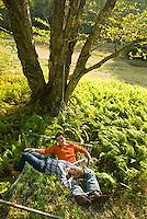 Couple relaxing in hammock<br />