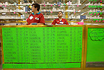 ALGODONES, MEXICO-March 22: Saleswomen wait for customers at one of several branches of Guadalahara Pharmacy March 22, 2005 in Algodones. There are more than a dozen pharmacies in town selling both name brand and generic medications to American customers. ©Radhika Chalasani